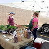 Margie Veseling talks with Danielle Stojan of Stojan's Vegetables in Maple Park during the opening day of the season for the Geneva Green Market.