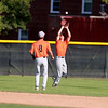St. Charles East's Austin Regelbrugge makes a catch in the outfield as teammate Reid Olson (8) looks on during their 1-0 loss to Lyons Township in a Phil Lawlor baseball tournament game at Benedictine University in Lisle Wednesday.