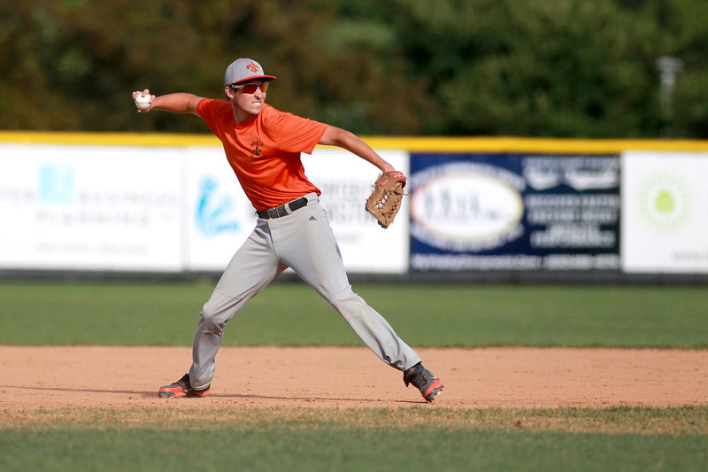 St. Charles East's Alex Abate throws to first during their 1-0 loss to Lyons Township in a Phil Lawlor baseball tournament game at Benedictine University in Lisle Wednesday.