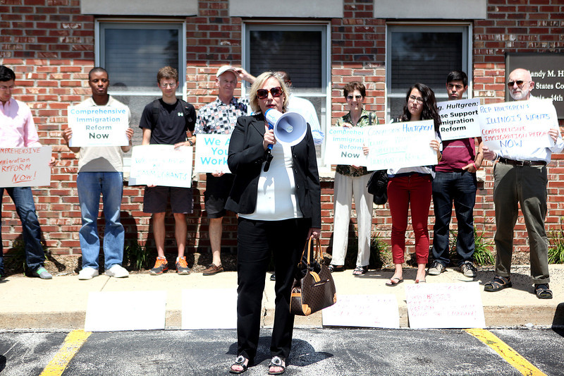 Jasna Ostojich speaks outside U.S. Rep. Randy Hultgren's, R-Winfield, Geneva office about her own immigration experience during a press conference Thursday. The press conference was hosted by the Chicago and St. Charles chapters of Organizing for Action.