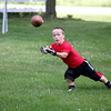 Tyler Buterbaugh, 15, makes a catch in the front yard of his family's Campton Hills home. Buterbaugh will be competing in the World Dwarf Games in Lansing, Mich. in August.