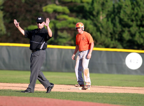 St. Charles East's Jon Finn looks on as an umpire makes a controversial call during their 1-0 loss to Lyons Township in a Phil Lawlor baseball tournament game at Benedictine University in Lisle Wednesday.