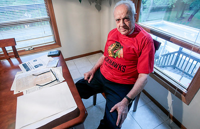 Sarah Nader - snader@shawmedia.com World War ll veteran George Marek, 90, of Johnsburg poses for a portrait at his daughters home Tuesday, June 25, 2013. Marek is a lifelong Blackhawks fan and was honored on the ice during the National Anthem at Game 5 of the Stanley Cup Finals.