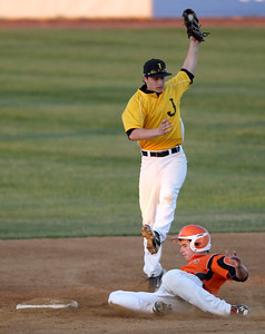 Sarah Nader - snader@shawmedia.com St. Charles East's Brian Sobieski slides under Jacobs' Grant Kale (left) while he slides to second during the second inning of Monday's IHSA 4A Supersectional at Rockford Aviators Stadium in Loves Park on June 3, 2013. St. Charles East won, 7-2.