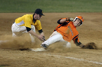 Sarah Nader - snader@shawmedia.com Jacobs' Jon berndt (left) tages out St. Charles East's Joe Hoscheit as he slides to third during the sixth inning of Monday's IHSA 4A Supersectional at Rockford Aviators Stadium in Loves Park on June 3, 2013. St. Charles East won, 7-2.