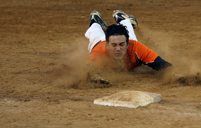 Sarah Nader - snader@shawmedia.com St. Charles East's Anthony Sciarinno safely slides to third during the third inning of Monday's IHSA 4A Supersectional against Jacobs at Rockford Aviators Stadium in Loves Park on June 3, 2013. St. Charles East won, 7-2.