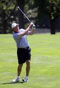 Jeff Krage – For Shaw Media Don Langland watches one of his fairway shots during Sunday's McHenry County Senior Amateur at Pinecrest Golf Club in Huntley. Huntley 6/30/13