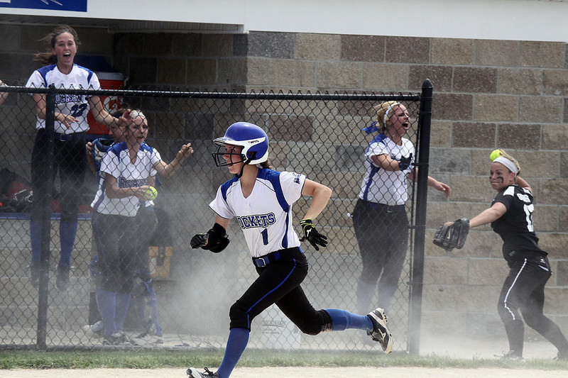 Jeff Krage – For Shaw Media<br /> With the score tied at five, Burlington Central's Courtni Neubauer races toward home plate in the bottom of the 7th inning as Kaneland's Rachel Goress, right, gets ready to make a throw during Saturday's IHSA class 3A regional championship at Burlington Central. Neubauer scored and the Rockets defeated the Knights 6-5.<br /> Burlington 5/31/14