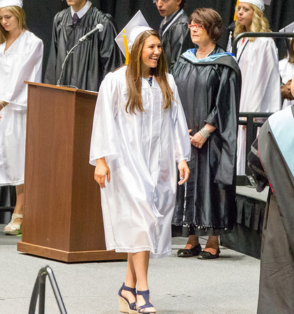 Kaneland High School graduate Lanie R. Callaghan walks the stage to receive her diploma during the school's commencement ceremony at NIU Convocation Center in DeKalb, IL on Sunday, June 01, 2014 (Sean King for Shaw Media)