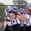 Jeff Krage – For Shaw Media<br /> Burlington Central's Kassidy Gaylord (#23, second from left) hugs Courtni Neubauer, left, after Neubauer scored the winning run in the bottom of the 7th inning during Saturday's 6-5 victory over Kaneland in IHSA class 3A regional championship at Burlington Central.<br /> Burlington 5/31/14