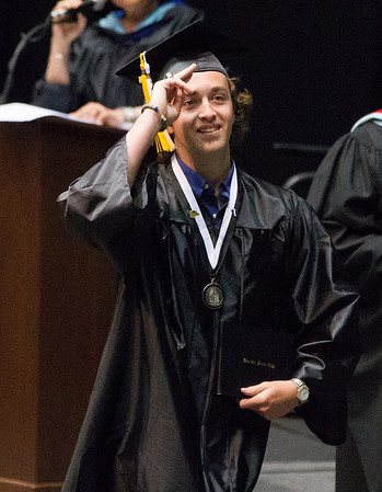 Kaneland High School graduate Nicholas M. Stollard acknowledges his family after receiving his diploma during the school's commencement ceremony at NIU Convocation Center in DeKalb, IL on Sunday, June 01, 2014 (Sean King for Shaw Media)