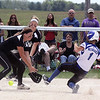 Jeff Krage – For Shaw Media<br /> With the score tied at five, the ball gets away from Kaneland pitcher Angie Morrow as she covers third base in the bottom of the 7th inning during Saturday's IHSA class 3A regional championship at Burlington Central. This allowed Burlington Central's Courtni Neubauer to score the game winning run.<br /> Burlington 5/31/14
