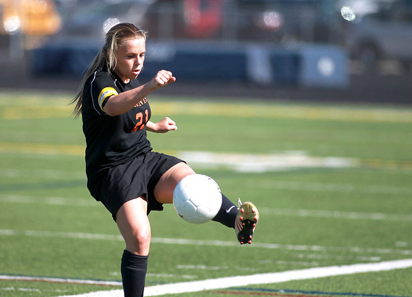 St. Charles East's Amanda Hilton kicks the ball during their Conant Sectional final against Conant in Hoffman Estates Friday.