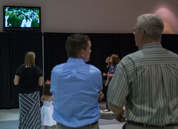 Family and Friends watch Kaneland High School graduates via a live broadcast during the school's commencement ceremony at NIU Convocation Center in DeKalb, IL on Sunday, June 01, 2014 (Sean King for Shaw Media)