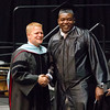 Kaneland High School graduate Jaumaureo V. Phillips shakes hands with Kaneland Superintendent Dr. Jeff Schuler after receiving his diploma during the school's commencement ceremony at NIU Convocation Center in DeKalb, IL on Sunday, June 01, 2014 (Sean King for Shaw Media)