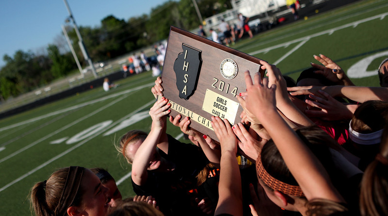 St. Charles East players celebrate their Conant Sectional final win over Conant in Hoffman Estates Friday.