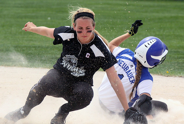 Jeff Krage – For Shaw Media<br /> Kaneland shortstop fields a throw as Burlington Central's Courtni Neubauer steals second base in the bottom of the 7th inning during Saturday's IHSA class 3A regional championship at Burlington Central.<br /> Burlington 5/31/14