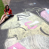 Jennifer Jordan, who is on break from Grand Valley State University in Michigan for the summer, created an elaborate homage to the Chicago Blackhawks in honor of their playoff run to the Stanley Cup in the driveway of her Campton Hills home Friday. Jordan was inspired to create the chalk art after attending Wednesday night's game at the United Center.