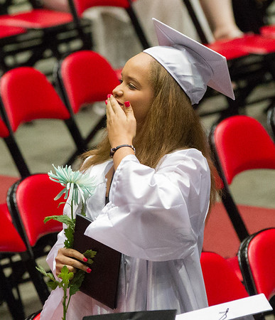 Kaneland High School graduate Azalia M. Wilkerson blows a kiss to her family after receiving her diploma during the school's commencement ceremony at NIU Convocation Center in DeKalb, IL on Sunday, June 01, 2014 (Sean King for Shaw Media)