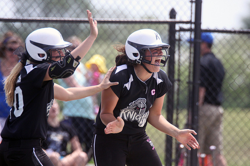 Jeff Krage – For Shaw Media<br /> Kaneland's Lanie Callaghan, right, screams toward second base, where Paige Kuefler stands after hitting a two-run, game-tying double to right field in the top of the 7th inning during Saturday's IHSA class 3A regional championship at Burlington Central. The Knights allowed a run in the bottom of the 7th inning and lost 6-5.<br /> Burlington 5/31/14