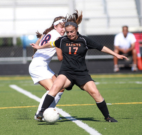 St. Charles East's Anna Corirosi (17) goes after the ball during their Conant Sectional final against Conant in Hoffman Estates Friday.