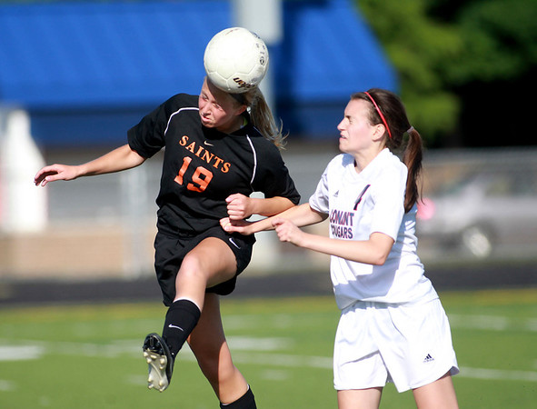 St. Charles East's Sophie Jendrzeczyk (19) heads the ball during their Conant Sectional final win over Conant in Hoffman Estates Friday.