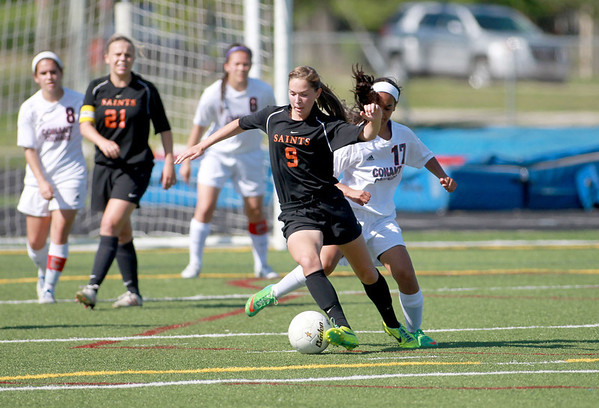 St. Charles East's Darcy Cunningham (9) goes after the ball during their Conant Sectional final against Conant in Hoffman Estates Friday.