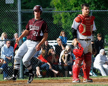 Huntley catcher Mark Skonieczny (20) stands at the plate as Prairie Ridge's Carson Getzlman (21) scores during the 5th inning of their IHSA Class 4A McHenry Sectional game at Peterson Park Wednesday, June 4, 2014 in McHenry, Ill. The Wolves won the game 5-1.  John Konstantaras photo for the Northwest Herald