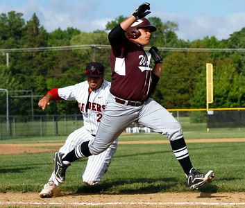 Huntley's Robert Thomm (24) tags out Prairie Ridge's Marcus Sargeant (30) on a sacrifice bunt in the 5th inning of their IHSA Class 4A McHenry Sectional game at Peterson Park Wednesday, June 4, 2014 in McHenry, Ill. The Wolves won the game 5-1.  John Konstantaras photo for the Northwest Herald