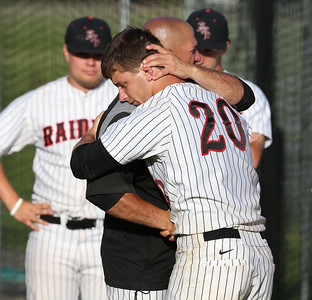 Huntley's Mark Skonieczny (20) gets a hug from head coach Andy Jakubowski after their IHSA Class 4A McHenry Sectional loss to Prairie Ridge at Peterson Park Wednesday, June 4, 2014 in McHenry, Ill. The Wolves won the game 5-1.  John Konstantaras photo for the Northwest Herald