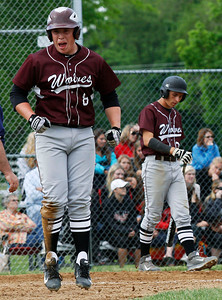 Prairie Ridge's Caleb Aldridge (8) celebrates after scoring on a wild pitch in the 4th inning of their IHSA Class 4A McHenry Sectional game against Huntley at Peterson Park Wednesday, June 4, 2014 in McHenry, Ill. The Wolves won the game 5-1.John Konstantaras - for the Northwest Herald