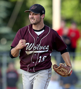 Prairie Ridge's John Myers (19) pumps his first after striking out Huntley's Matt Sullivan (26) to end their IHSA Class 4A McHenry Sectional game at Peterson Park Wednesday, June 4, 2014 in McHenry, Ill. The Wolves won the game 5-1.  John Konstantaras photo for the Northwest Herald