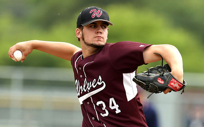Prairie Ridge's Benjamin Cilano (34) delivers a pitch during their IHSA Class 4A McHenry Sectional game against Huntley at Peterson Park Wednesday, June 4, 2014 in McHenry, Ill. The Wolves won the game 5-1.  John Konstantaras photo for the Northwest Herald