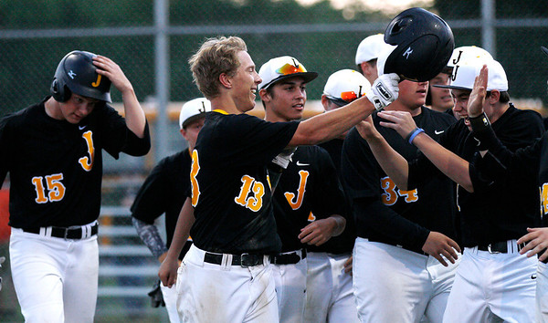 Jacob's Matt Kozlak (13) celebrates with his team after his firth inning home run during their IHSA Class 4A McHenry Sectional game against Hononegah at Peterson Park Wednesday, June 4, 2014 in McHenry, Ill. The Golden Eagles won the game 7-1.  John Konstantaras photo for the Northwest Herald