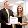 Kane County Chronicle General Manager Jim Ringness presents Wheaton Academy graduate Laura Vento of St. Charles with a $1,500 Chronicle Achievement Program scholarship sponsored by the Kane County Chronicle and KCT Credit Union. Vento will be attending Wheaton College.