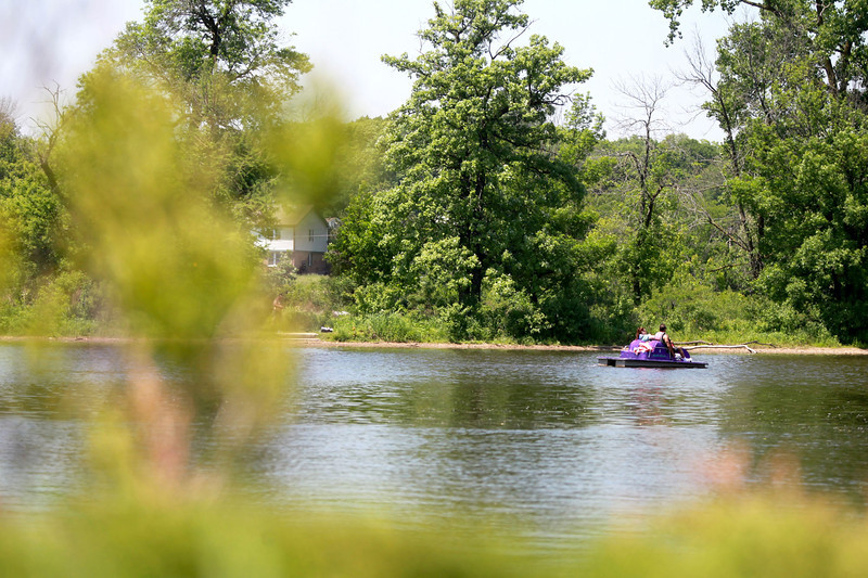 A group of peddle boaters cruise on the Fox River from Pottawatomie Park in St. Charles.