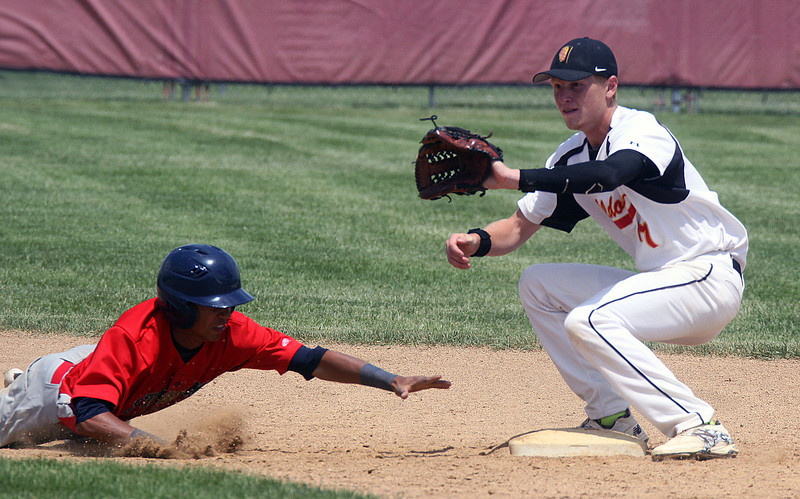 Jeff Krage – For Shaw Media<br /> Batavia shortstop Andrew Siegler waits for a pickoff throw as a South Elgin runner dives back into second base during Saturday's IHSA class 4A Schaumburg sectional final. The Bulldogs lost 8-3.<br /> Schaumburg 6/7/14
