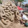 Sand Sculptor Ted Siebert of Woodstock, IL works on his sand sculpture of Medusa during The St. Charles River Fest at Pottawatomie Park in St.Charles, IL on Sunday, June 08, 2014 (Sean King for Shaw Media)