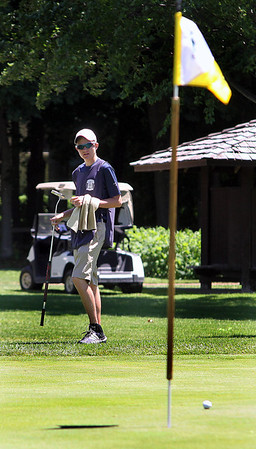 Jeff Krage – For Shaw Media<br /> Caddy Matt Samuelson holds a golf club near the 16th green during the Fox Chase at the St. Charles County Club on Friday.<br /> St. Charles 6/13/14