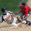 Jeff Krage – For Shaw Media<br /> Batavia's Steven Busby is tagged out at home plate by South Elgin pitcher Max Keough after a pass ball in the 4th inning of Saturday's IHSA class 4A Schaumburg sectional final. The Bulldogs trailed 5-3 at the time.<br /> Schaumburg 6/7/14