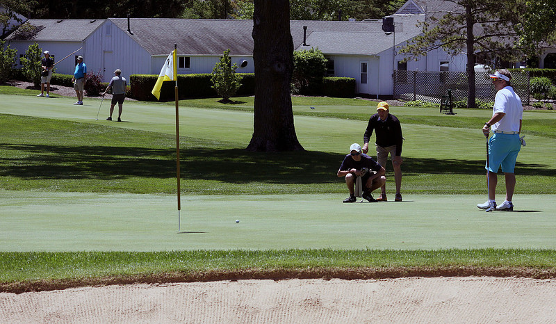 Jeff Krage – For Shaw Media<br /> Caddy Matt Samuelson (squating) checks the tilt of the green during the Fox Chase at the St. Charles County Club on Friday.<br /> St. Charles 6/13/14