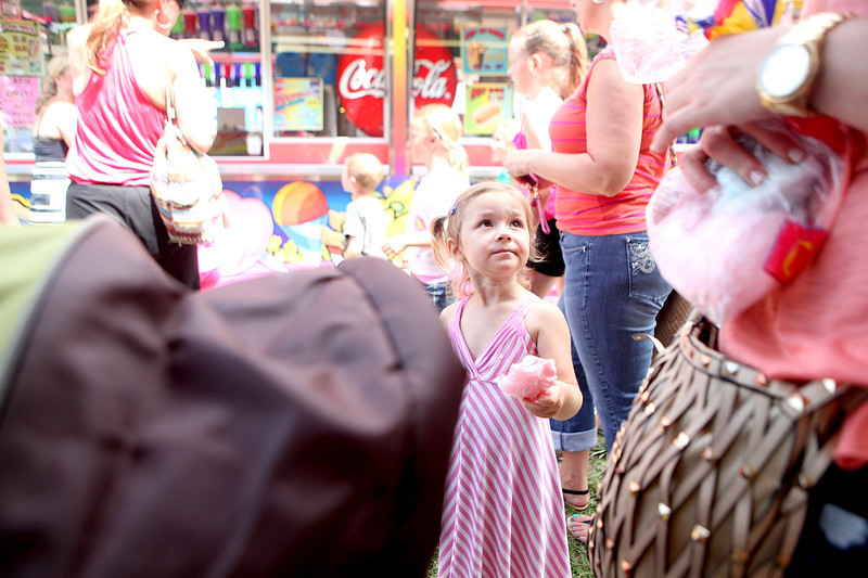 Naia Goudis, 3, of St. Charles eats some cotton candy during Swedish Days in downtown Geneva Thursday.