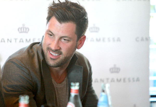 Dancing with the Stars professional dancer Maksim Chmerkovskiy greets guests at Aliano's in Batavia for an exclusive trunk showing of his line of men's jewelry Friday.