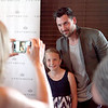 Dancing with the Stars professional dancer Maksim Chmerkovskiy poses for a photo with 7-year-old Samantha Vanda of Batavia as Samantha's mom, Pam, takes the photo at Aliano's in Batavia during an exclusive trunk showing of his line of men's jewelry Friday.