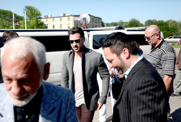 Dancing with the Stars professional dancer Maksim Chmerkovskiy (center) arrives at Aliano's in Batavia for an exclusive trunk showing of his line of men's jewelry Friday.