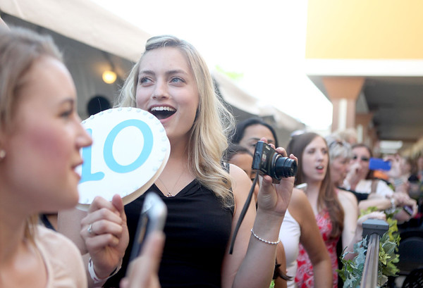 "Stephanie Seydone of Elgin holds a sign with a ""10"" score on it as she waits for Dancing with the Stars professional dancer Maksim Chmerkovskiy to arrive at Aliano's in Batavia for an exclusive trunk showing of his line of men's jewelry Friday."