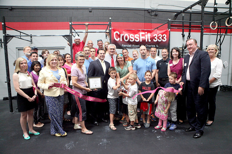St. Charles Chamber of Commerce and St. Charles Mayor Ray Rogina (center) join CrossFit 333 owners Sonia and Blake Murray to cut the ribbon to their new business. CrossFit 333 is located at 333 Randall Road, Suite 4 in St. Charles.
