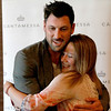 Dancing with the Stars professional dancer Maksim Chmerkovskiy hugs Kayla Taylor, 16, of Oswego at Aliano's in Batavia during an exclusive trunk showing of his line of men's jewelry Friday.