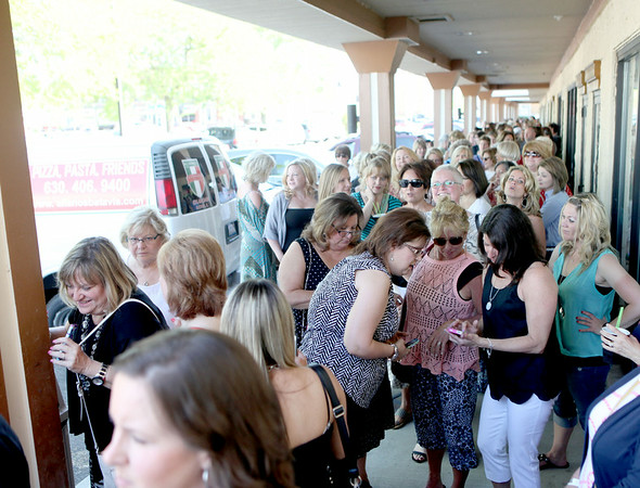 People wait in line to meet Dancing with the Stars professional dancer Maksim Chmerkovskiy at Aliano's in Batavia for an exclusive trunk showing of his line of men's jewelry Friday.