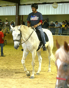 H. Rick Bamman - hbamman@shawmedia.com Air Force veteran Ljdo Corderon performas in the arena at the  Annual BraveHearts Heroes on Horseback horse show.